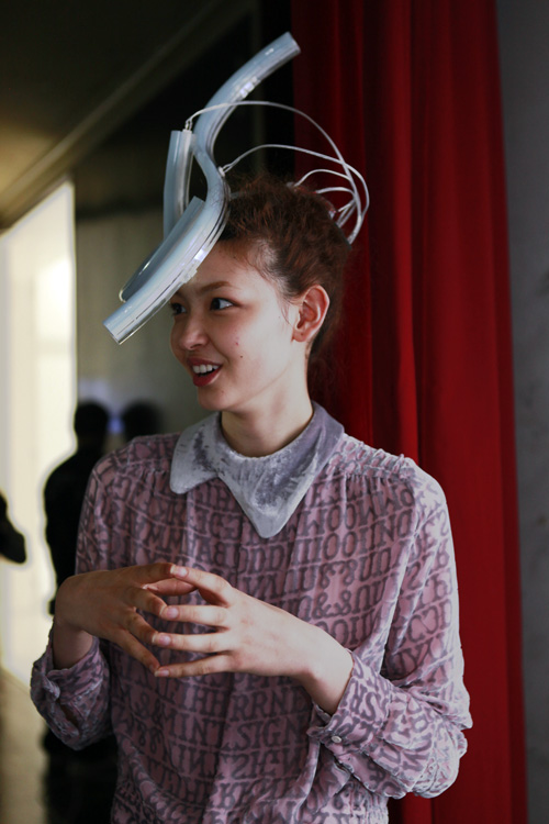a model wears a fluorescent tube hat at mintdesigns aw 2011 tokyo