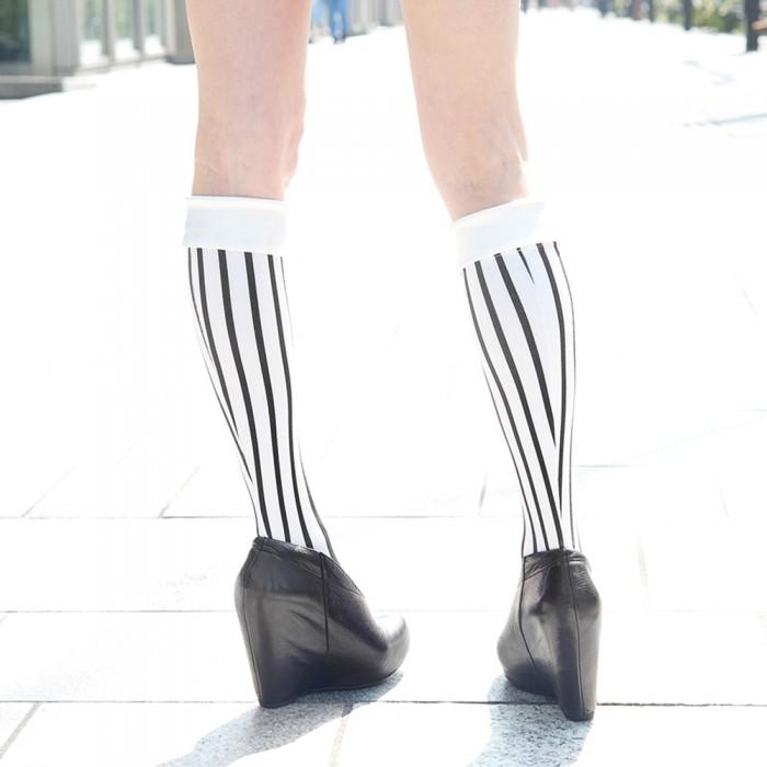 model wearing white kneehigh striped Erimaki Sox